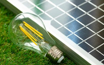 Solar energy panel and light bulb, green energy concept